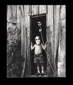 Ralph Eugene Meatyard  Masked Boy Standing in Doorway, 1959