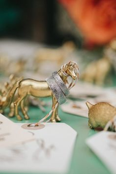figurines // photo by Kate Miller Photography // http://ruffledblog.com/whimsical-illinois-barn-wedding