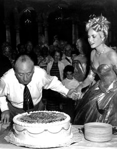 "Alfred Hitchcock & Grace Kelly on the set of ""To Catch a Thief"""