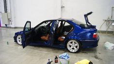 Avus blue BMW e36 sedan on cult classic AC Schnitzer type 1 wheels and camel interior & vader seats.