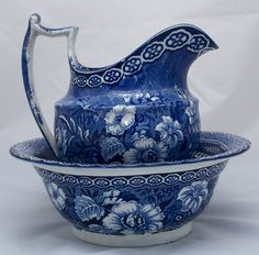 Blue and white transferware pitcher.
