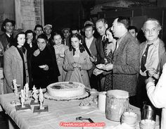 """The cast and crew of The Wizard of Oz threw a """"going away"""" party on the set of The Wizard of Oz for director Victor Fleming on 17th February, 1939, who is leaving to direct Gone with the Wind."""