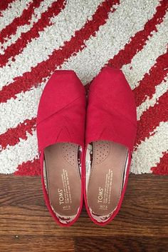 The original red slip-on. Classic and bold. TOMS Shoes.