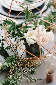 Copper green industrial modern wedding centerpiece via 100 Layer Cake. Coordination/concept by Luxe and Luna Couture Events. Photography by Sarah Street Photography. Venue at Work Release, Norfolk, Virginia. Floral styling and tablescape by Michelle Samson of Taffy Floral. Flatware from Target. Dinnerware from Kate Spade. Chargers, Crate & Barrel. Bulbs, Brooklyn Bulb Co.