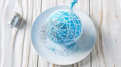 Glitter sprinkled on wool and balloon | Christmas string baubles | Tesco Living