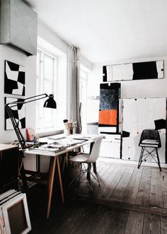 Beautiful workspace filled with artwork. No photographer credit, boo.
