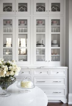 Beautiful white kitchen inset cabinets glass doors marke countertops Elegant Kitchen  Kitchens Blue ceilings and Glass