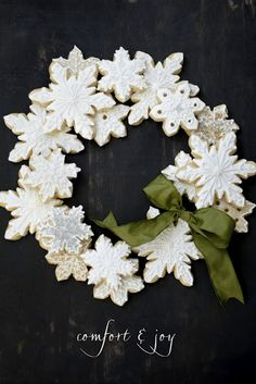 snowflake cookie cutters, white clay, glitter and you have an adorable wreath!