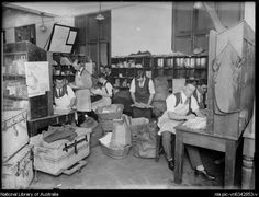 Men sorting through mail and parcels from England, New South Wales, ca. 1920s [picture].