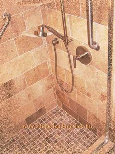Fürdőszoba kád melletti részébe épített zuhanyzó