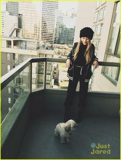 Sabrina Carpenter with a dog.
