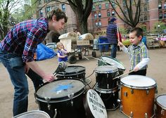 New Haven-Steve Fox (L), of Occupy Delaware, plays percussion with a young musician as Occupy New Haven celebrates 6 months on the Green. Melanie Stengel/Register