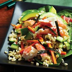 1 cup short-grain brown rice 1 tbsp wasabi paste 2 tbsp low-sodium soy sauce 2/3 cup rice wine vinegar 1/2 tsp raw honey 1 English cucumber, diced into 1/4-inch chunks 4 nori sheets, quartered and cut into 1/4-inch strips 1 large carrot, peeled and thinly sliced  8 oz crab meat pieces (claw or jumbo lump) 1 avocado, pitted, peeled and sliced 4 cups baby spinach