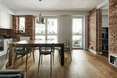 Dining room with sculptural chairs and exposed brick walls