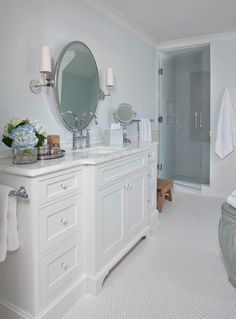 Every thing in this is lovely, the mirror, the vanity, the penny rounds on the floor!