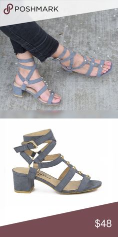"""Layla Sandals  LIMITED SIZES LEFT  Go ahead and get your rocker babe on with this  Grey Suede Studded Leg Wrap Heels! Vegan suede straps are dotted with flat gold studs atop a peep-toe upper. Long straps wrap around leg and secure with an adjustable gold buckle. 2"""" wrapped block heel. Cushioned insole. Nonskid rubber sole. All vegan friendly, man made materials. Imported. Jubis Boutique  Shoes Sandals"""