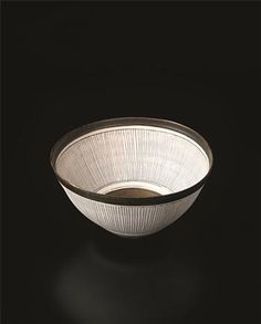 Bowl, Porcelain, manganese glaze with radiating sgraffito and inlaid designs repeated inside and out. 23 cm (9 in) diameter, c.1980