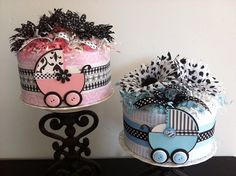 A classic theme, pink and black baby carriage, with a modern twist adding black and white damask, gingham and floral prints... perfect for a baby girl! This mini diaper cake makes a great shower gift or decoration/centerpiece for a baby shower. It would also make a stylish nursery decoration after the shower and is easily disassembled when the baby is ready to use the diapers  #timelesstreasure