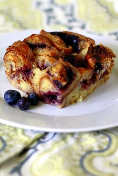 """BERRY CROISSANT BREAD PUDDING: Preheat oven to 350. Coat 9"""" baking pan w/cooking spray. Cut 4 croissants in half lengthwise. Spread 1tbsp berry preserves on each half. Replace tops & cut croissants into strips. Place strips in baking pan. Dab 4tbsp preserves on top. In a bowl, whisk 3 eggs, 14oz sweetened condensed milk, 3/4c water, 2tbsp melted butter, 1tsp vanilla extract, and cinnamon. Pour mixture over croissants. Let set 5 minutes. Bake about 45 minutes. Sprinkle with confectioners…"""