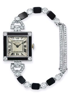 AN ART DECO DIAMOND AND ONYX WRISTWATCH, BY CARTIER  With mechanical movmement, the square cream dial with black Roman numerals, within a black onyx bezel set with four European-cut diamonds, to the old European and single-cut diamond and onyx bracelet with deployant rose-cut diamond clasp, mounted in platinum and 18k gold, 1922, 5¾ ins. Signed Cartier, nos. 0580, 20591 and 12159; Movement signed E.W.  C. Co. for European Watch  Clock Co. With certificate of authenticity from Cartier