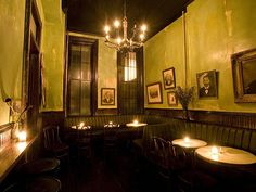 Distressed green walls, portraits, and dark ceiling - Hotel Delmano