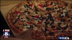 Autumn orders pizza right to the set for National Sausage Pizza Day.