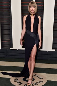 Taylor channeled her inner Angelina Jolie leg at the Oscars after-parties.