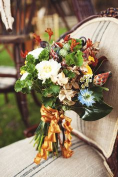 rustic #autumn bouquet // photo by eephotome.com // flowers and styling by SweetSundayEvents.com #fallweddings #weddingbouquets http://ruffledblog.com/galleries/town-and-country-wedding-ideas/?pid=86689
