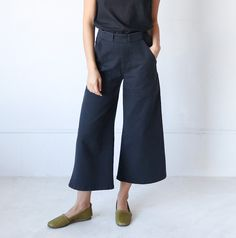 Individual Medley | Sabrina Washed Black Pant | Size |  Made from structured black cotton and featuring side zip, elongated front pockets, and cropped wide trouser leg. Waistband is slightly high-rise.