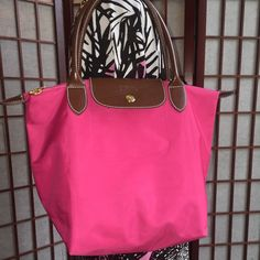 Longchamp Le Pilage Med. Tote pink good condition medium size clean inside and out. Very minimal sign of use in corners. Longchamp Bags Totes