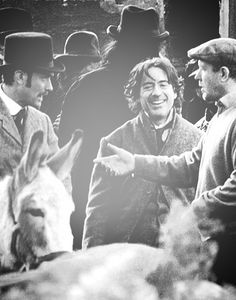 """Jude Law, Robert Downey Jr. and Guy Ritchie on the set of """"Sherlock Holmes"""""""
