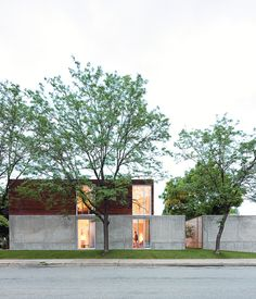 """The home's mix of dark ipe wood, concrete, and glass give credence to Winter's description of it as """"an open bunker.""""  Photo by Dean Kaufman."""
