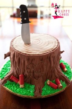Great Grooms Wedding Cake! Rustic Tree Stump Log (just not fondant icing) maybe with arrowns instead of a knife :)