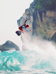 Getting some air above a turquoise sea. Awesome surf moment.