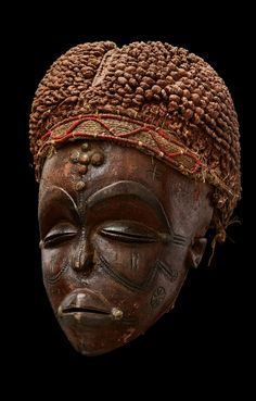 Africa | Mask from the Tshokwe people of Angola | Wood, fiber and glass beads | April 2013 Catalogue