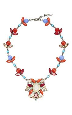 Redefining luxury statement pieces, this brilliant statement piece by **Sharra Pagano** puts an eccentric spin on traditional jewelry with vibrant resin crystals and elaborate forms.
