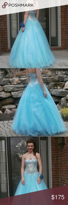Blue gown with gems This dress is worth a lot and is in great shape. I wore it once for my prom. The stomach area is mesh with rhinestones. It comes padded for a B cup size. The dress is a size 6/7. This dress zips up and is strapless. Dresses Prom