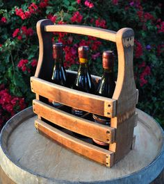 Sturdy oak carrier securely holds three wine bottles for transport and display. Wine not included.