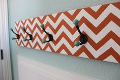 25 Best Chevron Projects - orange chevron coat rack from The Sweet Survial