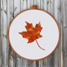 red maple leaf cross stitch pattern, an interesting modern geometric design