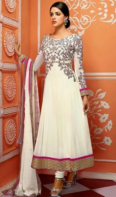 Be the perfect picture of elegance bedecked in this ivory embroidered georgette Anarkali churidar suit. This stunning attire is displaying some astounding embroidery done with floral patch, lace and resham work. #OutstandingPartyWear