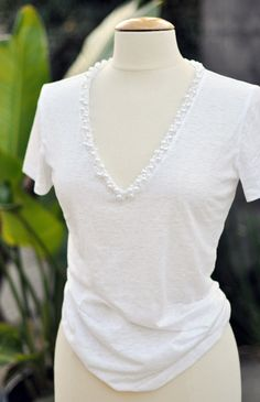 DYI pearl incrusted v-neck t-shirt! I need to do this!
