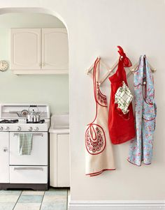 Multiple Aprons    In the mid-20th century, most women relied on two kinds of aprons: a practical one for cooking and cleaning, and fancier versions for hostess duty. According to EllynAnne Geisel, author of The Apron Book, the hand-sewn examples shown here are worth between $15 and $20.