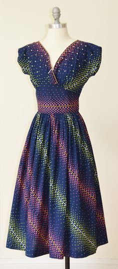 Fantastic 1950s dotted dress with pearl and crystal embellishments.