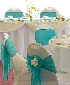 to Decorate Wedding Reception Chairs - Tiffany style LIKE THE IDEA NOT THE COLORS Wedding Flowers Simple white chair covers have been transformed with the addition of a generous turquoise bow - a silk orchid completes the look for this stylish wedding. Wedding Reception Chairs, Reception Decorations, Table Decorations, Teal Wedding Decorations, Reception Ideas, Wedding Lanterns, Wedding Tables, White Chair Covers, Seat Covers
