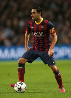 Xavi Hernandez of Barcelona in action during the UEFA Champions League Round of 16 first leg match between Manchester City and Barcelona at the Etihad Stadium on February 18, 2014 in Manchester, England.