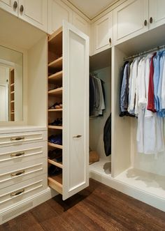 ❧ closets - walk-in built-in cabinets vertical pull-out shoe cabinet Amazing walk-in closet with floor to ceiling creamy white cabinets and vertical