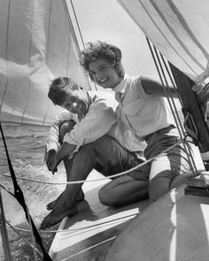 Jacqueline Bouvier sitting with her fiance, Sen. John Kennedy, on the deck of small sailboat as they cruise the waters of Cape Cod on July 7, 1953.