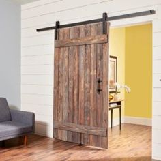 If youve investigated rustic barn doors youve probably gotten sticker shock. But we can help. In this article well show you how to build a simple barn door including how to distress new pine boards for a weathered look. Wooden Barn Doors, Rustic Doors, Barn Wood, Sliding Door Design, Diy Sliding Barn Door, Sliding Doors, Diy Room Divider, Divider Ideas, Diy Barn Door Hardware