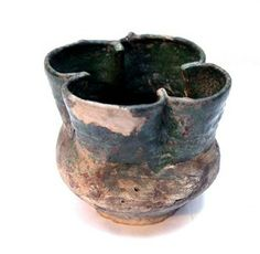Cup; earthenware; Tudor Green Ware; with quatrefoil mouth and bulging body; partially glazed green.